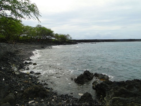Picture of black rock beach at The Dumps in the Ahihi Kinau Natural Area Reserve, Maui, Hawaii.