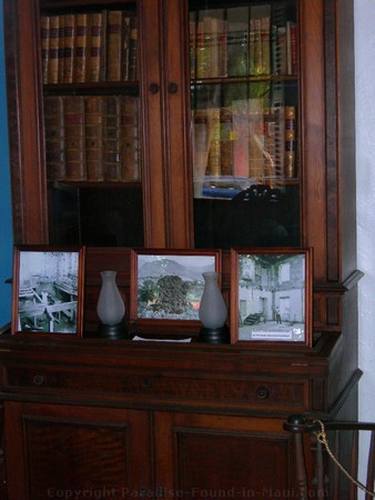 Picture of the bookcase in the Baldwin Home Museum on Front Street, Lahaina on the island of Maui, Hawaii.