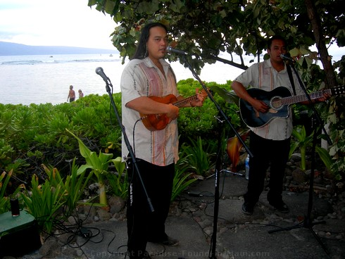 Picture of live musicians at the Feast at Lele, one of the best Maui luaus.