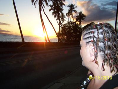 Picture of woman staring into sunset on Maui.
