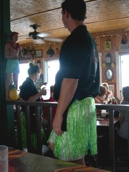 Picture of a male server wearing a colourful hula skirt at the Cheeseburger in Paradise Maui restaurant in Lahaina.