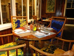 Picture of seating near the kitchen of the Hula Grill Maui in Whaler's Village.