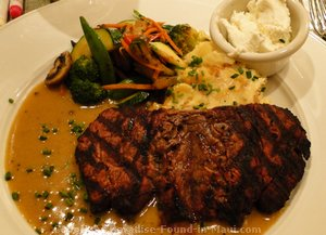 Picture of filet special with sake cream sauce and mashed potatoes with applewood smoked bacon and goat cheese at the Hula Grill Maui in Whaler's Village.