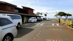 Picture of Taxi Vans waiting outside the West Maui Kapalua Airport terminal building on the island of Maui, Hawaii.