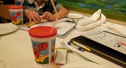 Picture of kids colouring supplies and cool kids cups at the Lahaina Grill, one of the best restaurants in Maui, Hawaii.