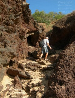 Picture of a man climbing the trail to Little Beach Maui at the base of the Pu'u Ola'i cinder cone at the north end of Big Beach