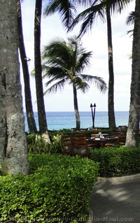 Picture of an outdoor ocean view dining table at the Ritz Carlton Kapalua Maui.