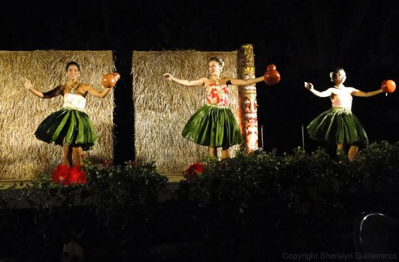 Trio of female hula dancers at Maui's Sheraton Luau