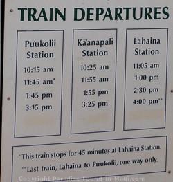 Picture of Sugar Cane Train Departure Schedule Sign.
