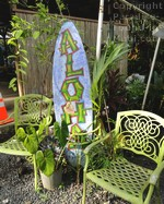 picture of aloha surfboard at Nahiku marketplace along the road to Hana on the island of Maui, Hawaii.