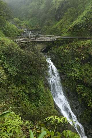 Road to Hana Maui one lane bridge with waterfall