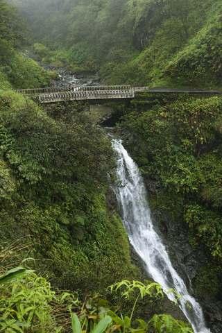Road to Hana Maui one lane bridge with waterfall