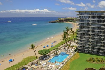 Picture of swimming pool overlooking the Pacific Ocean and the exterior of the Whaler on the island of Maui, Hawaii