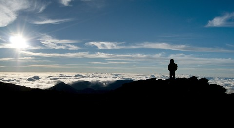 Person watching sunrise on Haleakala.