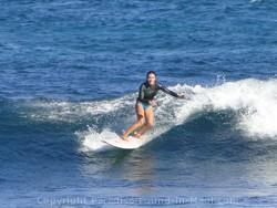 female surfer hookipa