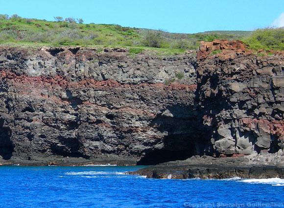 Snorkeling under sea cliffs at the Island of Lanai, Hawaii
