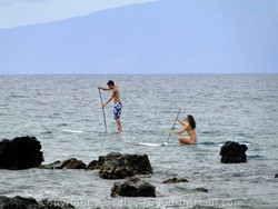 Picture of standup paddleboarding off Maui, Hawaii.