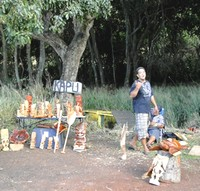 Picture of tikis and masks for sale along the highway in Maui, Hawaii.