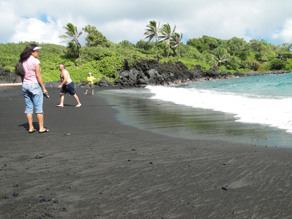 sand and surf at black sand beach on Maui