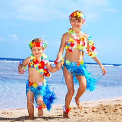 kids dressed up in hula attire for a luau