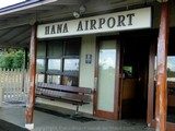 Picture of the Hana Airport Terminal and Welcome Sign in Maui, Hawaii.