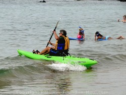 Picture of someone on an ocean kayak at Ulua Beach, Wailea, Maui, Hawaii.