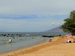 Picture of sunbathers and swimmers at Ulua Beac, Wailea, Maui, Hawaii.