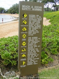 Picture of warning sign at Ulua Beach, Maui, Hawaii.