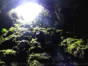 Picture of people cave exploring inside the Hana Lava Tube (Kaeleku Caverns) on the island of Maui, Hawaii.