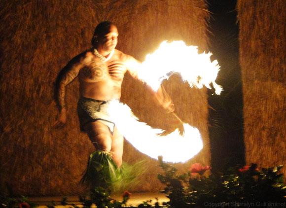 Fire knife dancer at Sheraton luau on Maui