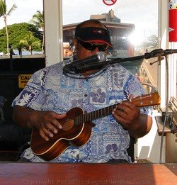 Picture of ukulele playing narrator on the Sugar Cane Train, Maui, Hawaii.