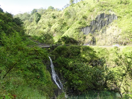 Picture of a waterfall under a one-lane bridge along the Road to Hana.