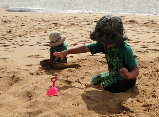 Kids playing on the beach in Maui.
