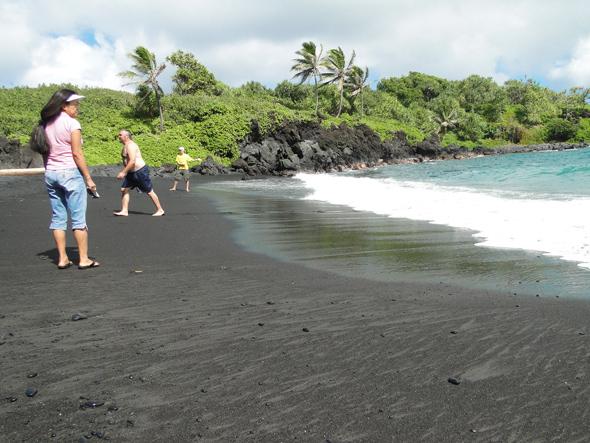 sand and surf at black sand beach on Maui