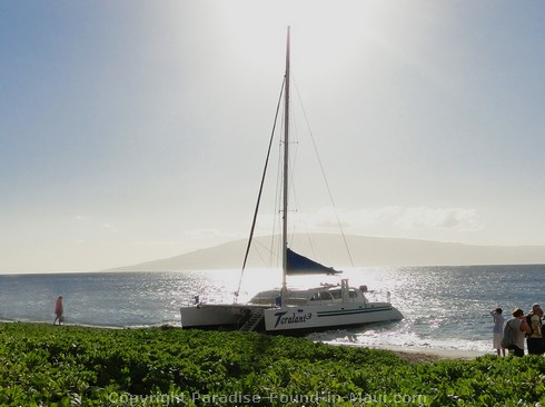 Picture of the Teralani catamaran on Kaanapali Beach.