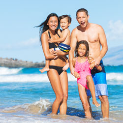 family on the beach in Maui
