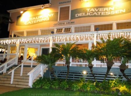 Haliimaile General Store exterior lit up at night.